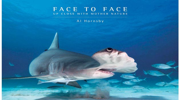 Well-known Industry Figure Al Hornsby signing his book, Face to Face: Up Close with Mother Nature During DEMA Show 2017